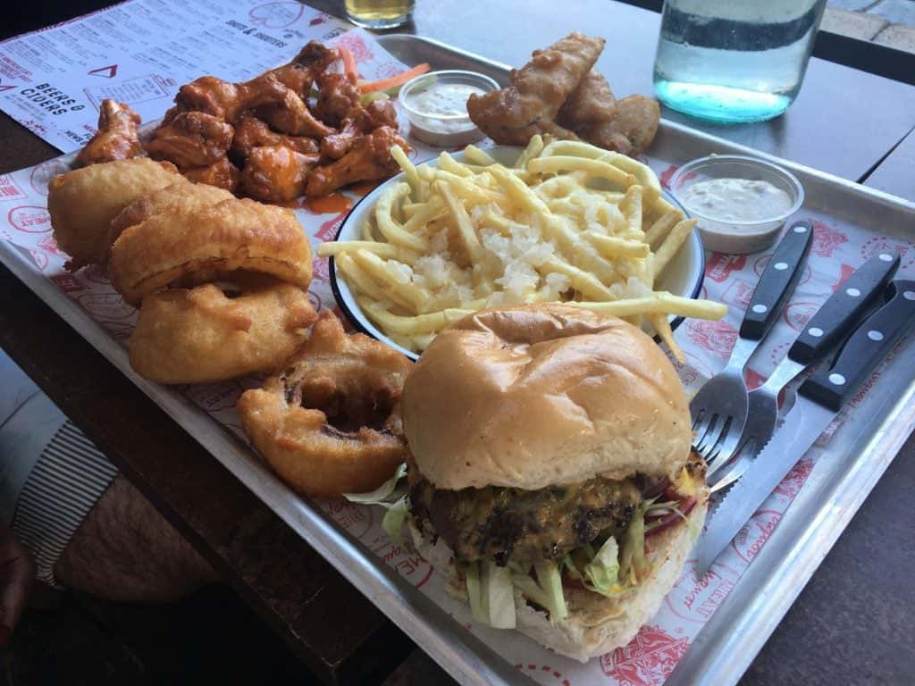 Buffalo Wings, Fried Pickles, Onion Rings and Fries at Meat Liquor N1. Photo credit: Kevin Lee