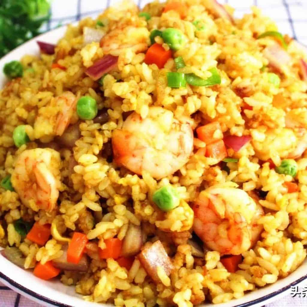 Fried rice with shrimp, ham bits and mixed vegetables