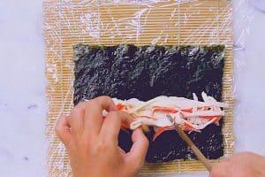 Arrange the kamaboko on the nori sheet