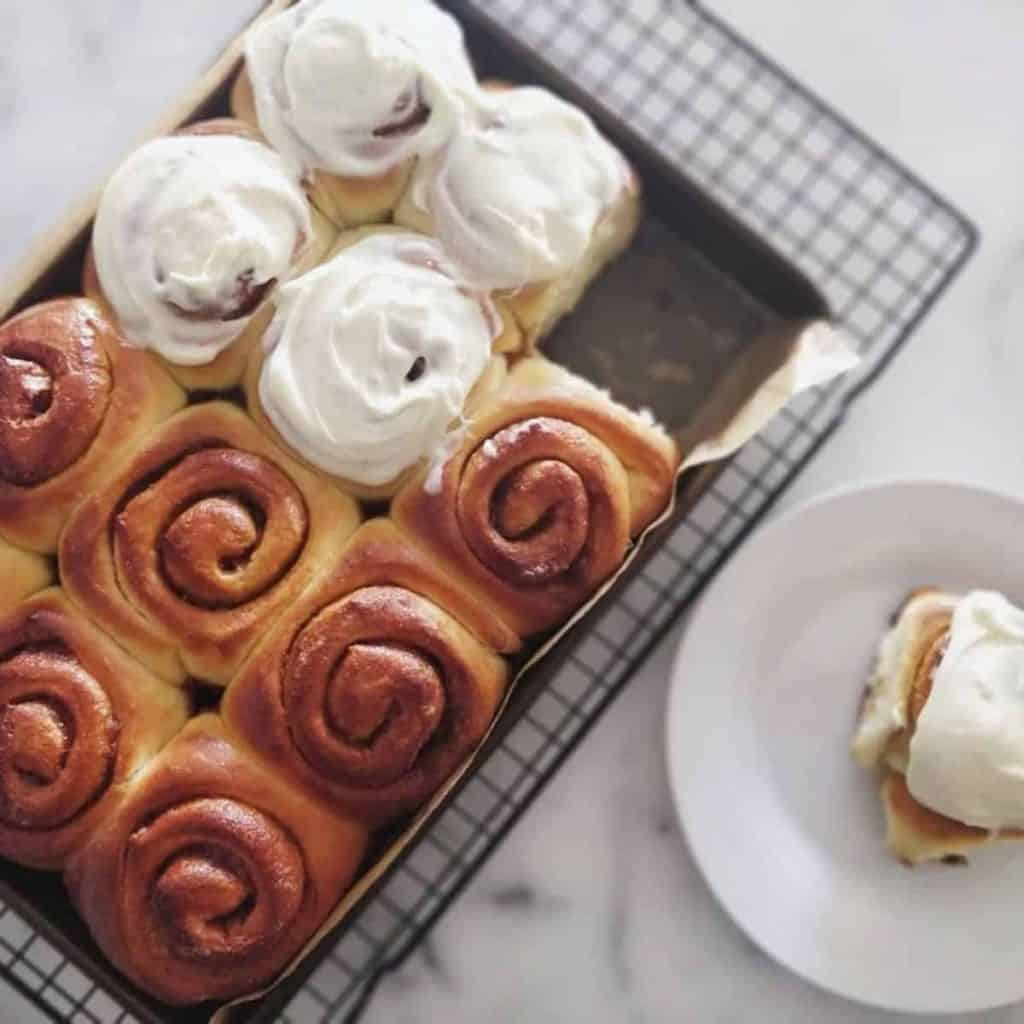 Cinnamon scrolls with cream cheese topping