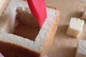 Coat honey and butter inside the loaf