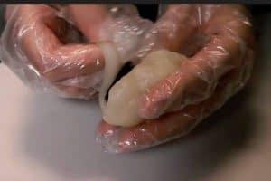Flatten the cut dough and fold it around a dollop of azuki paste