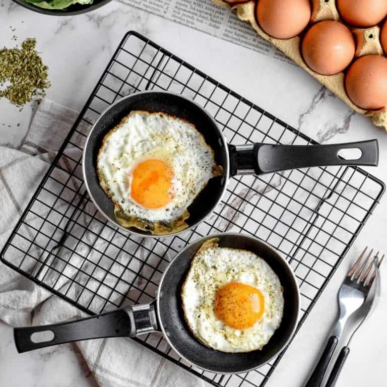 Fried eggs cooked in pans