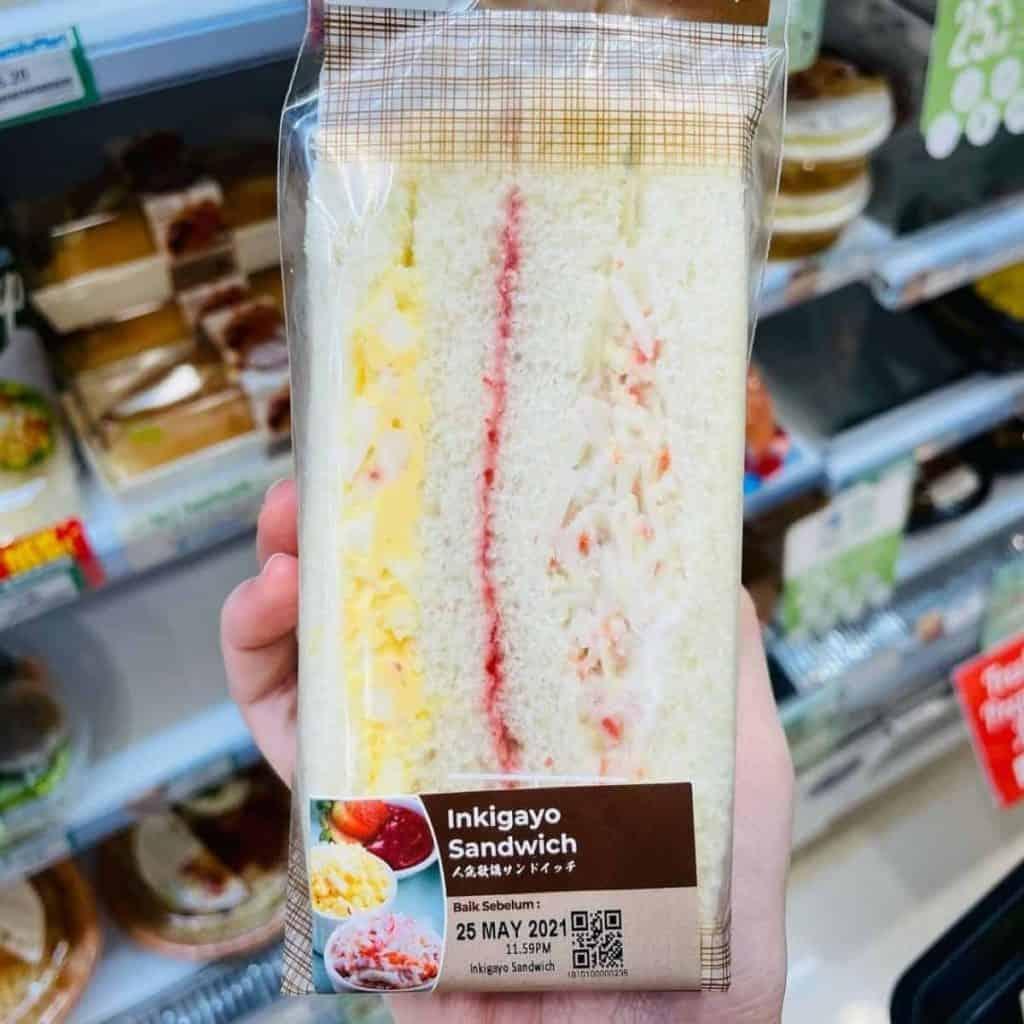 Korean snack with potato egg slaw, cabbage slaw and strawberry jam