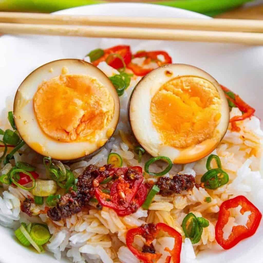 Korean soy sauce eggs over rice