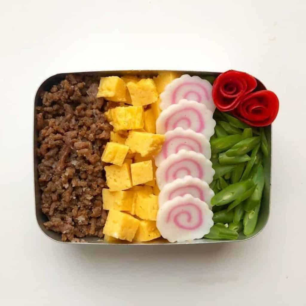 Narutomaki as part of a Japanese bento lunch box