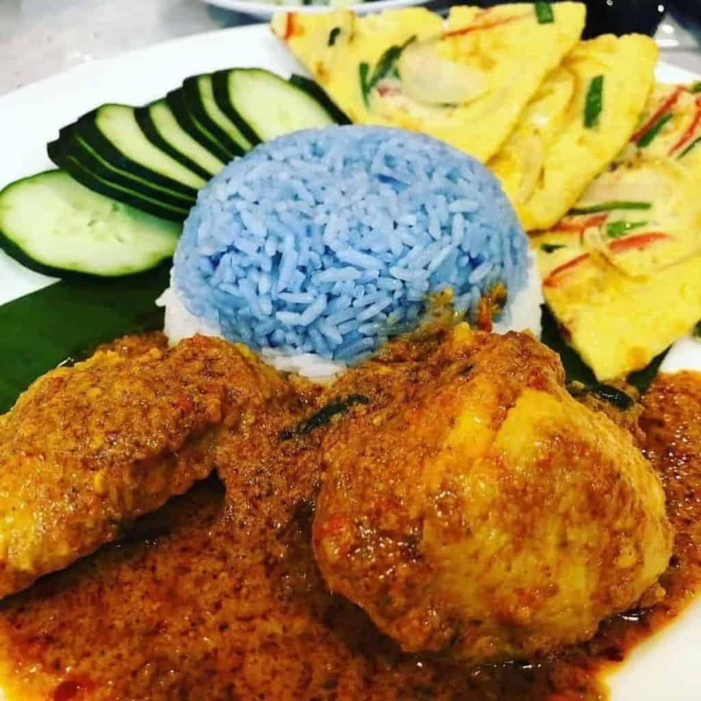 Nasi Lemak butterfly pea coloring rendang and omelete.