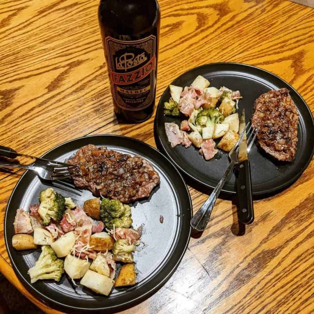 Onion tenderised steak served with roasted potatoes and vegetables