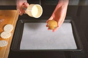 Place the dough and filling ball in the mould