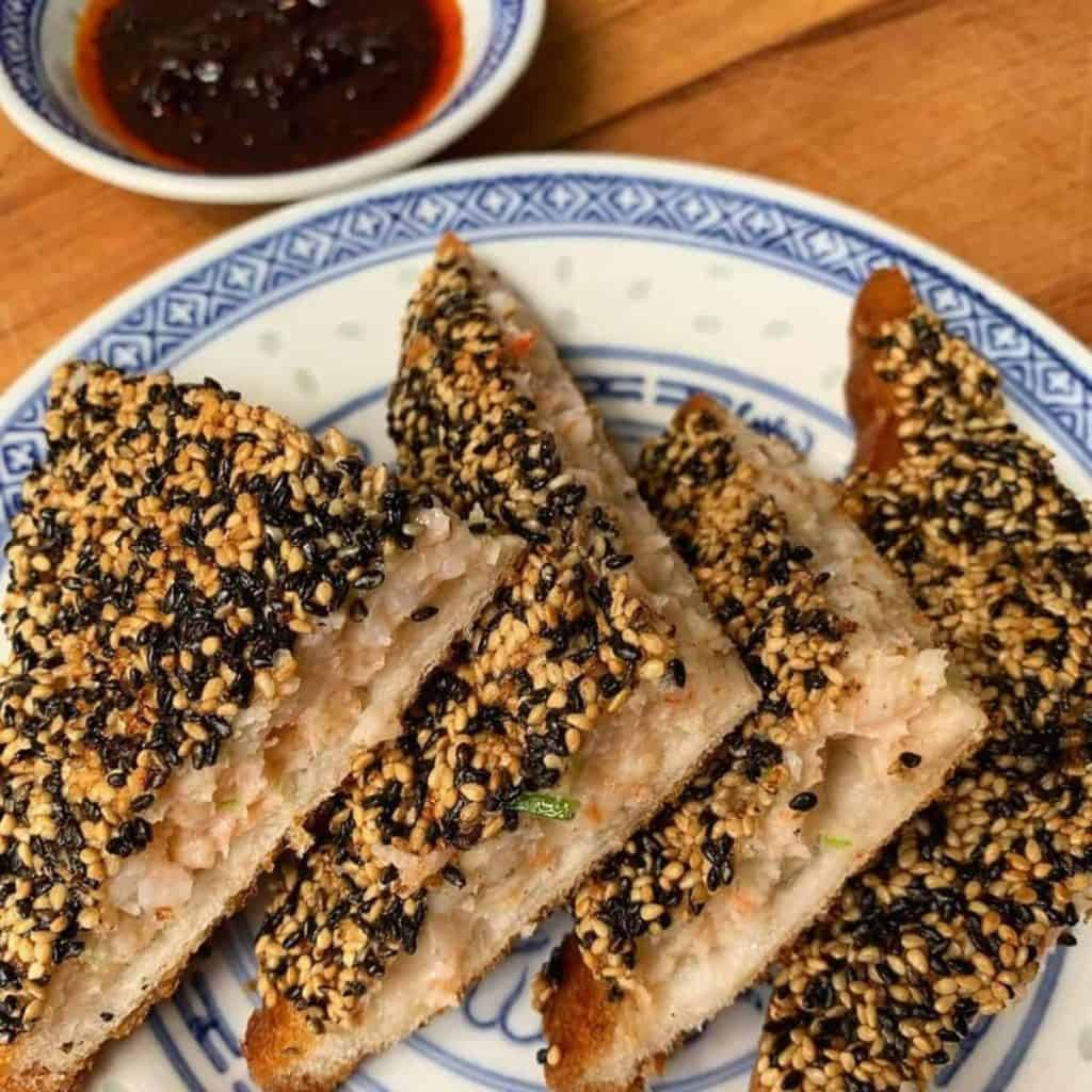 Chinese traditional snack made with shrimp paste, black and white sesame with sauce