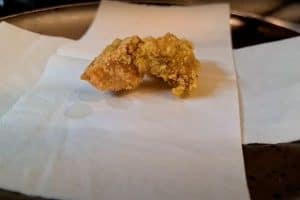 Take the fried pieces out and place on a paper towel