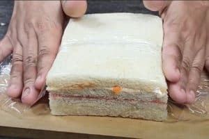Wrap the sandwich with cling wrap