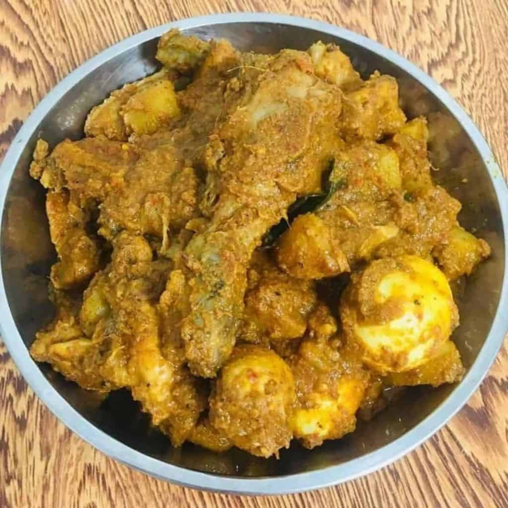 Spiced chicken with potato and egg