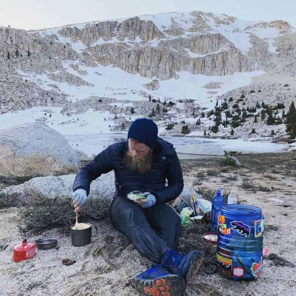 Carl Stanfield making ramen bomb while on the Pacific Crest Trail