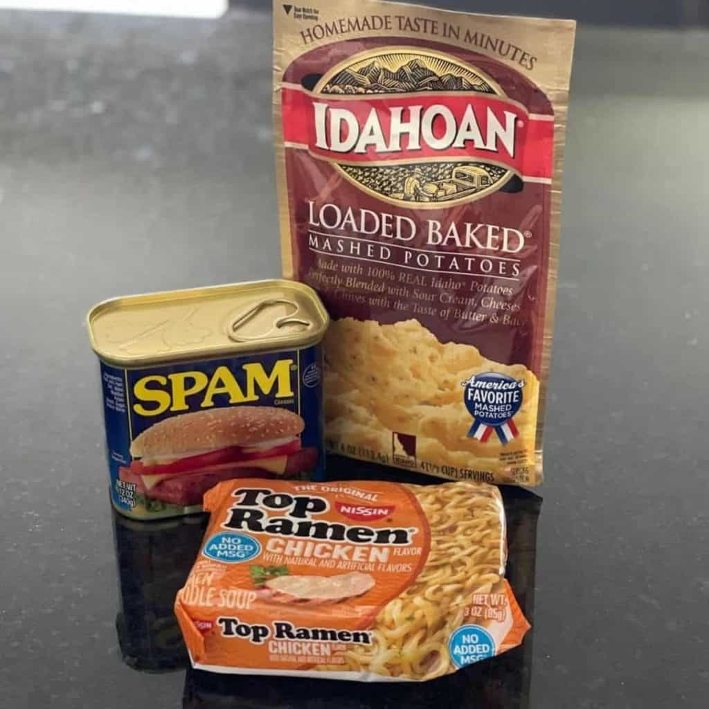 Packs of noodles, mashed potatoes and spam are all you need