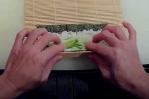Roll the maki using the bamboo mat