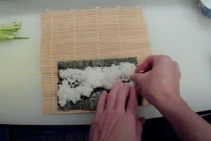 Spread rice evenly on nori