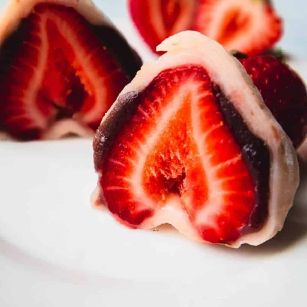 Strawberry mochi with red bean paste closeup