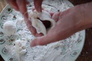 Wrap the dough around the strawberry