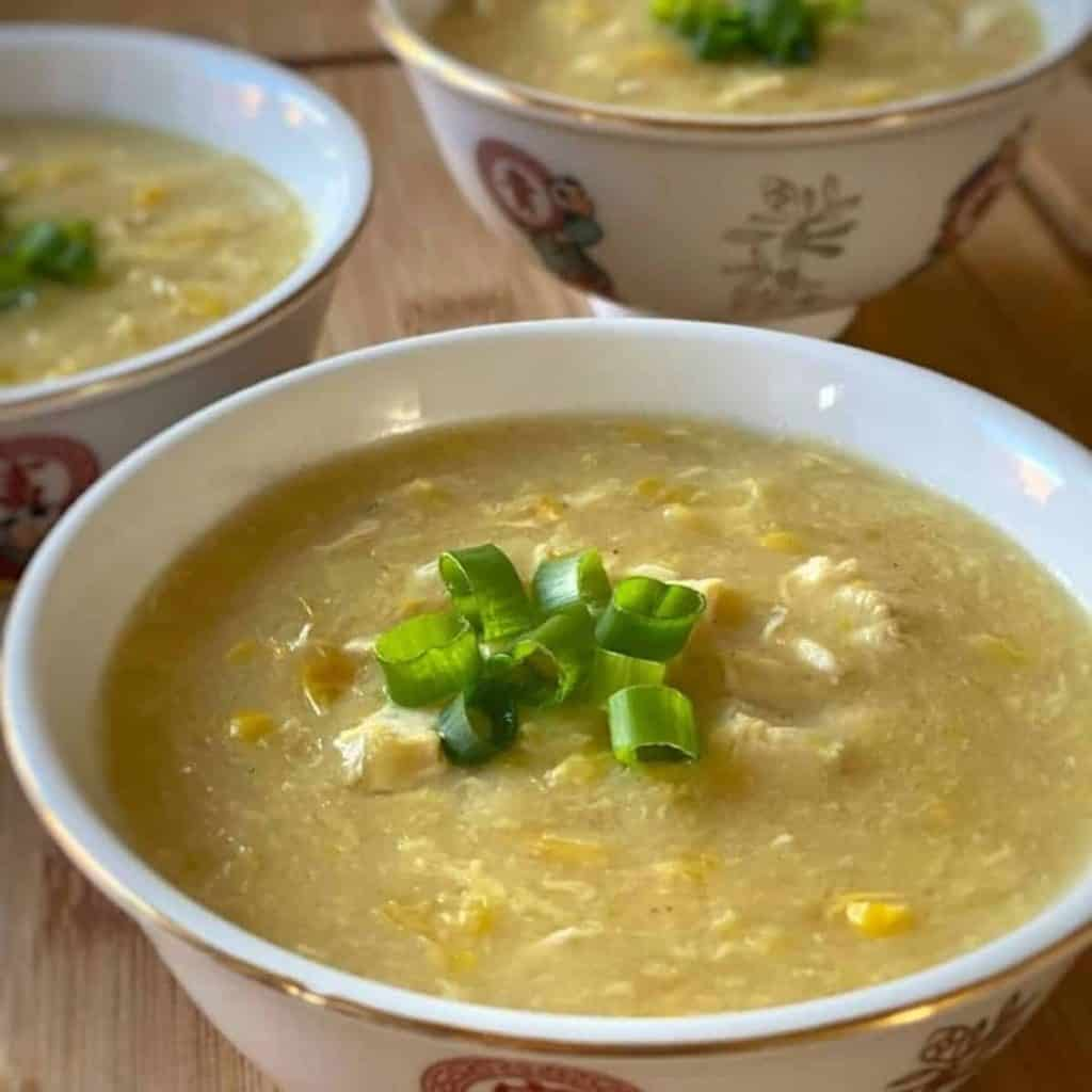 three servings of chicken and sweetcorn soup